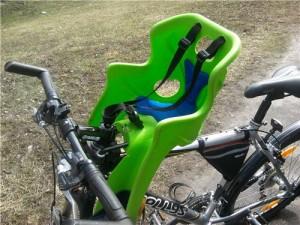 Безопасно ли детское велокресло с креплением на раму впереди велосипедиста?